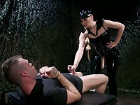 Mistress in latex puts on strapon and fucks anus of one kinky submissive