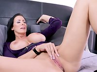 Reagan Foxx masturbates using her talented fingers on the bed