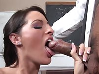 Teen is in front of blackboard, getting her tight pussy licked