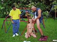 Outdoor sex in a park for this gorgeous young redhead